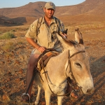 "Dr. Jeff Muntifering, shown here on ""donkey patrol"", leads the Zoo's efforts to save black rhinos in Namibia (photo by Save the Rhino Trust)"