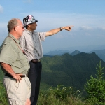 Dr. Ron Tilson (left) led international tiger conservation efforts in China (pictured here) and Indonesia